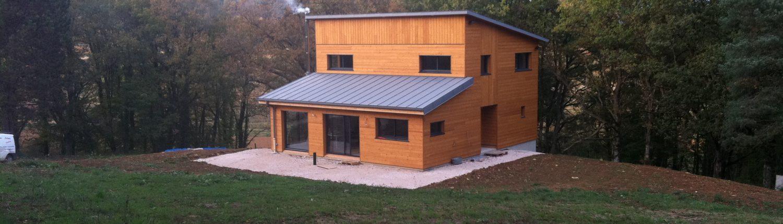 Maison bbc a ossature bois l 39 art du toit for Construction bois zinc